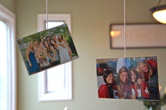 Old photos hanging from string. Cute!